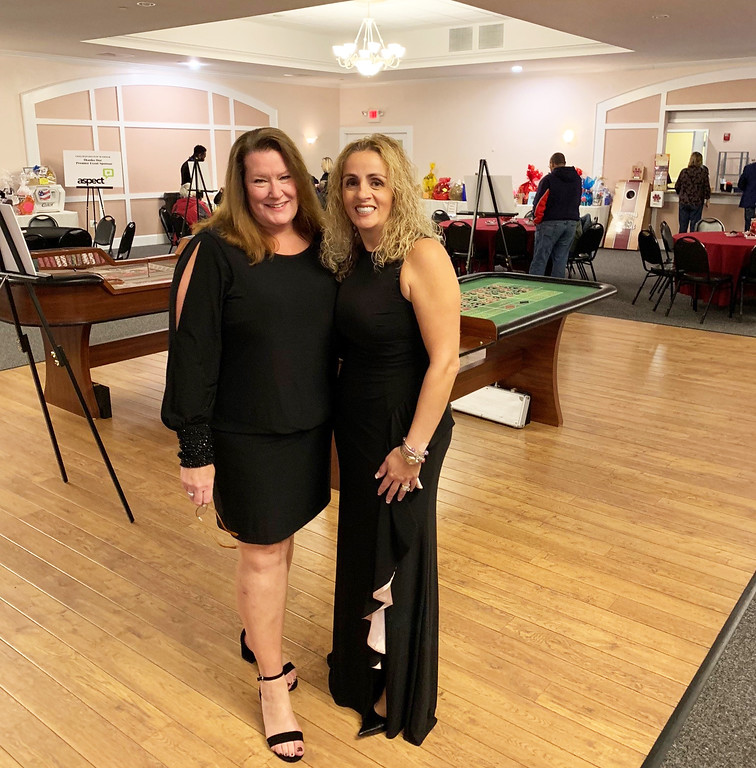 . Patti O�Brien and Chelmsford Pop Warner President and Chairwoman Angela Dulac, both of Chelmsford