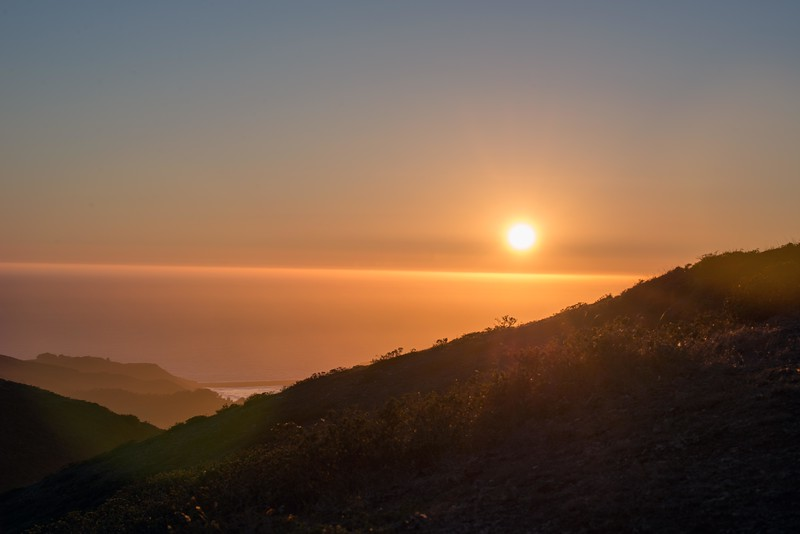 September 19, 2013.   Sunset over the Pacific Ocean as seen from the Marin Headlands near the Golden Gate Bridge.  The Harvest Moon would rise as soon as the sun set.