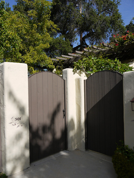 """The gate to our corner cottage, #301. Over the next 2 days, we ate lots of weeds, drank broth, looked forward to veggies, did the zumba, learned yoga on a big ball, hiked, walked, did water aerobics, drank contraband wine, did """"relaxing yoga at bedtime"""", got beautiful with body treatments and facials, and capped it all off with a fashion show starring Janice."""