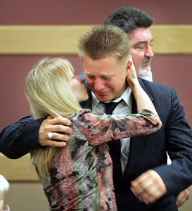 Broward County Judge Gold sentences Shawn Strawser.  Here Lisa Marie Strawser kisses her son Shawn for the last time before he is sentenced by Judge Gold.  In the background is Devlin Strawser (dad). Once a defendant is sentence there can be no physical contact afterward.