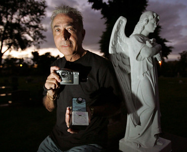 Bob Grasso is a speech pathologist  and Little League Coach by day, and ghost hunter by night.  Grasso searches out creepy places with his camera and his tri-field meter that measures electro magnetic energy in search of visions of ghosts or orbs.  Grasso has a website where he displays his photos.  This is Grasso at Evergreen Cemetery in Ft. Lauderdale.