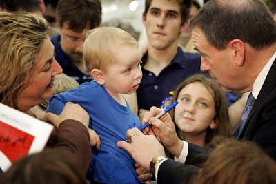 Republican presidential candidate  Mike Huckabee had a rally with his supporters at an airplane hanger at Ft. Lauderdale Executive Airport.  L TO R ARE; Mom, Shari Sopourn of Coral Springs holds her baby Jordy (age 16 months) to have his shirt signed by Mike.