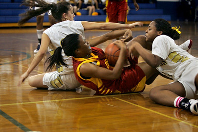 St. Thomas vs. Deerfield Beach High girls Basketball.; L to R are: Christina Diaz (St. Thomas); Princess Stewart (Deerfield) and Susan Beauzil (St. Thomas).; The three fight for the ball all the way to the floor in the close game.