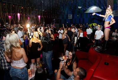 The Museum of Art/ Ft. Lauderdale had a party at Gryphon Night Club on Friday, September 25.  People celebrate and listen to the music as Museum of Art slides are projected on small screen.