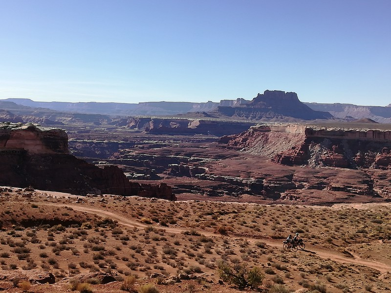 The White Rim road is named for the thick layer of white rock at the top of this level of the canyon