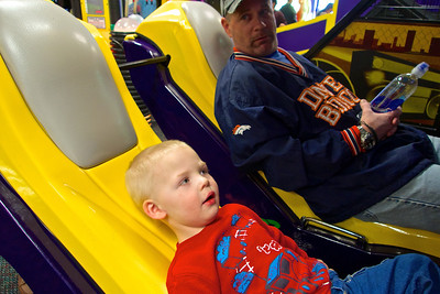 Birthday Party frenzy at Chuck E. Cheese's, Grandpa & Kadin ready to take off...