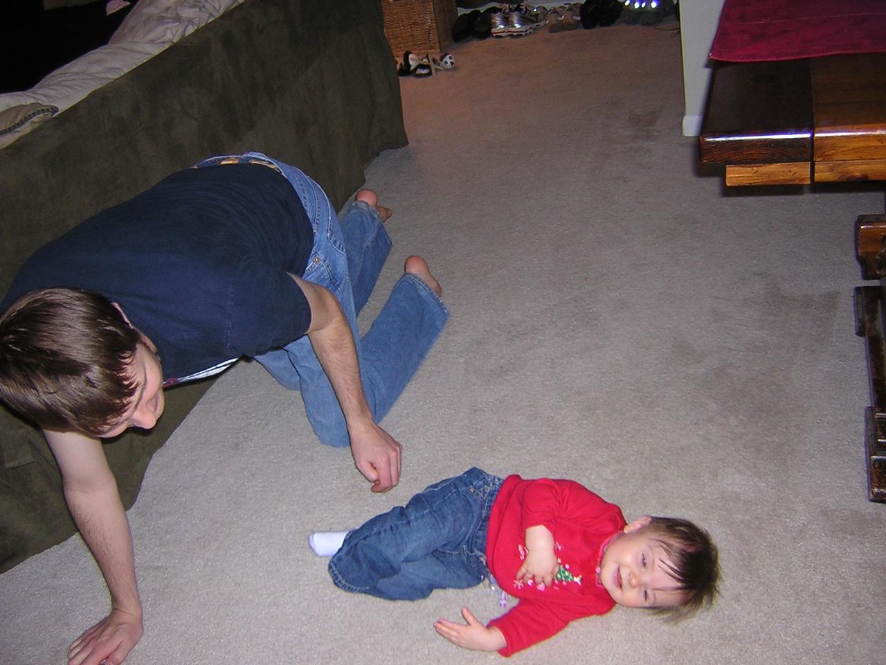 Uncle Roger tries to teach Stella to crawl.nDSCN6140.JPG