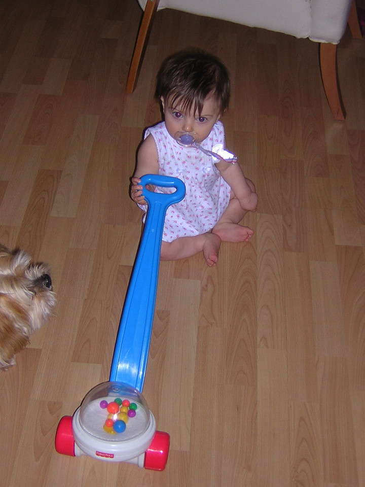 Stella plays with her popcorn popper from her Baba and Grandaddy.nDSCN6088.JPG
