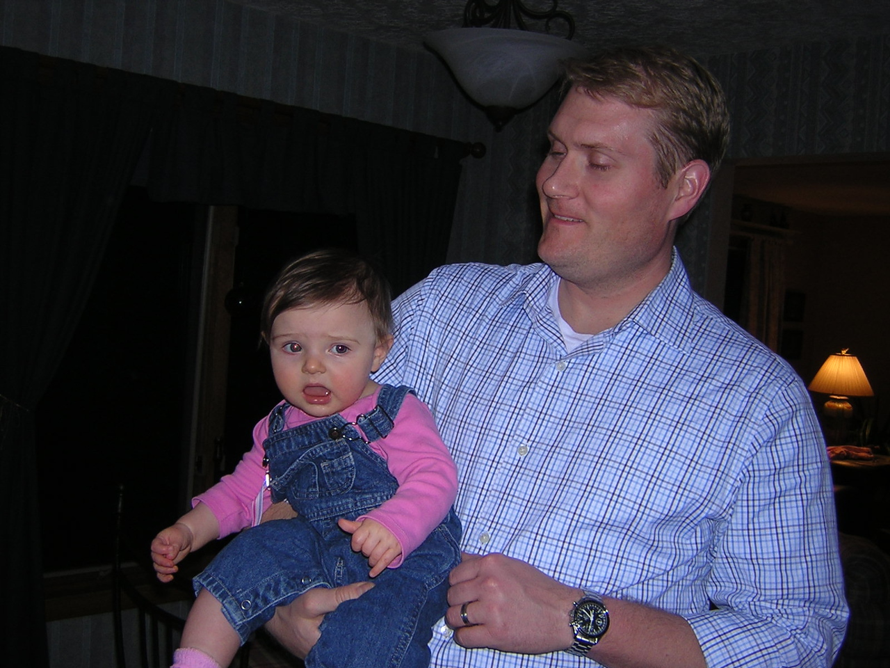 Stella chills with her Uncle Ryan.nDSCN5775.JPG
