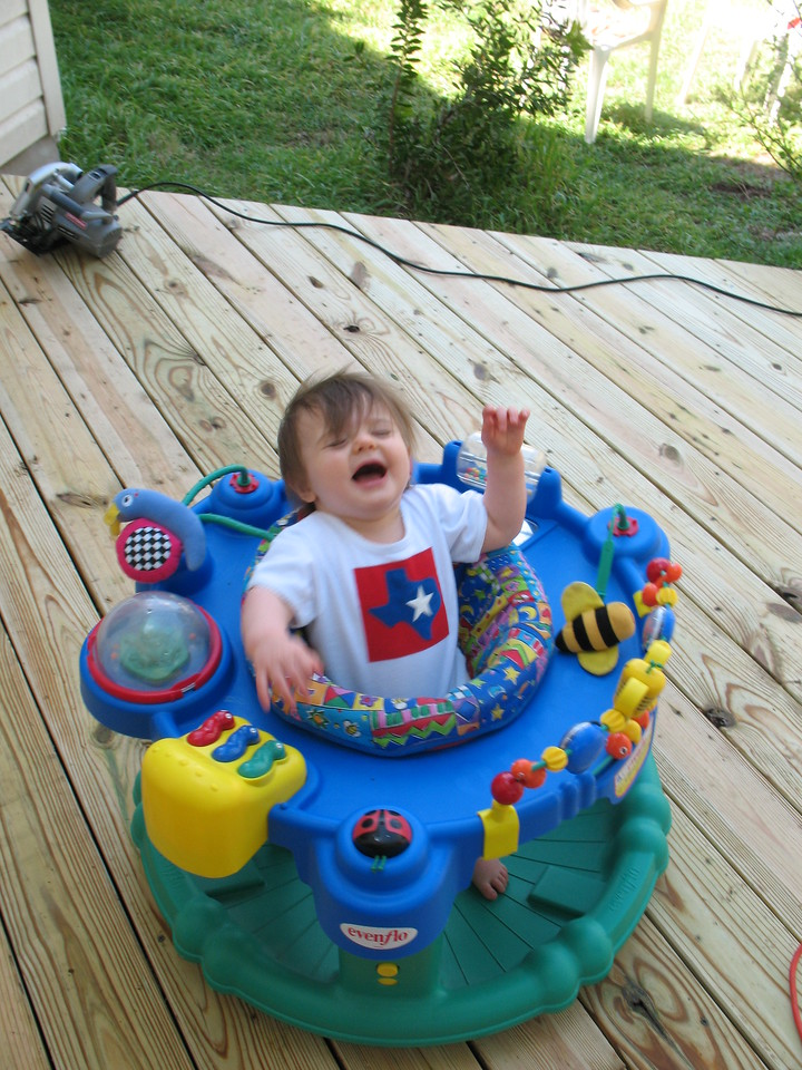 Refusing her exersaucer so Mommy and Daddy can work on the deck