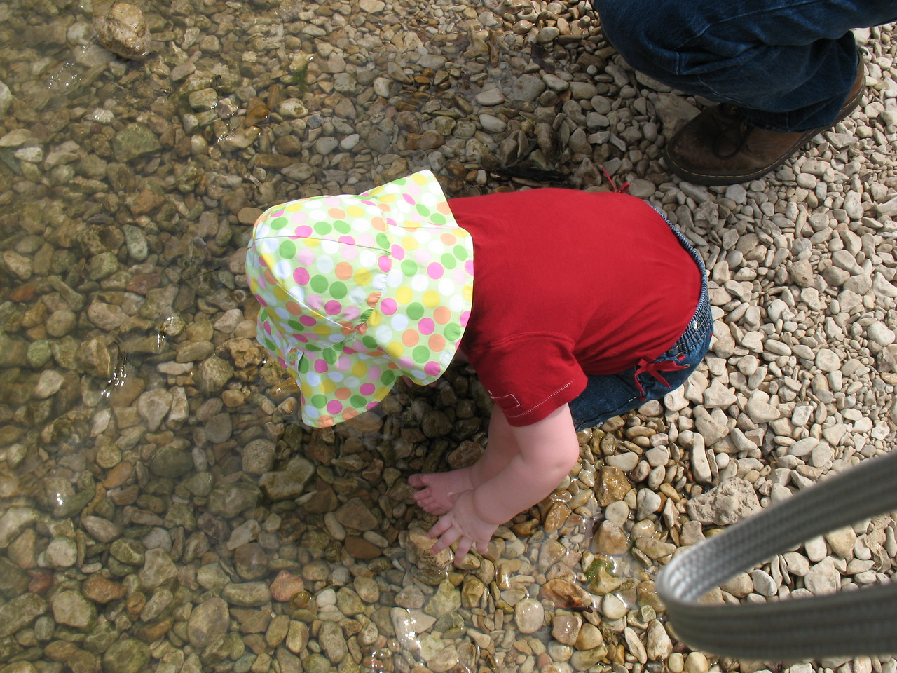 Playing in the water in Salado. She threw a fit when we tried to leave.