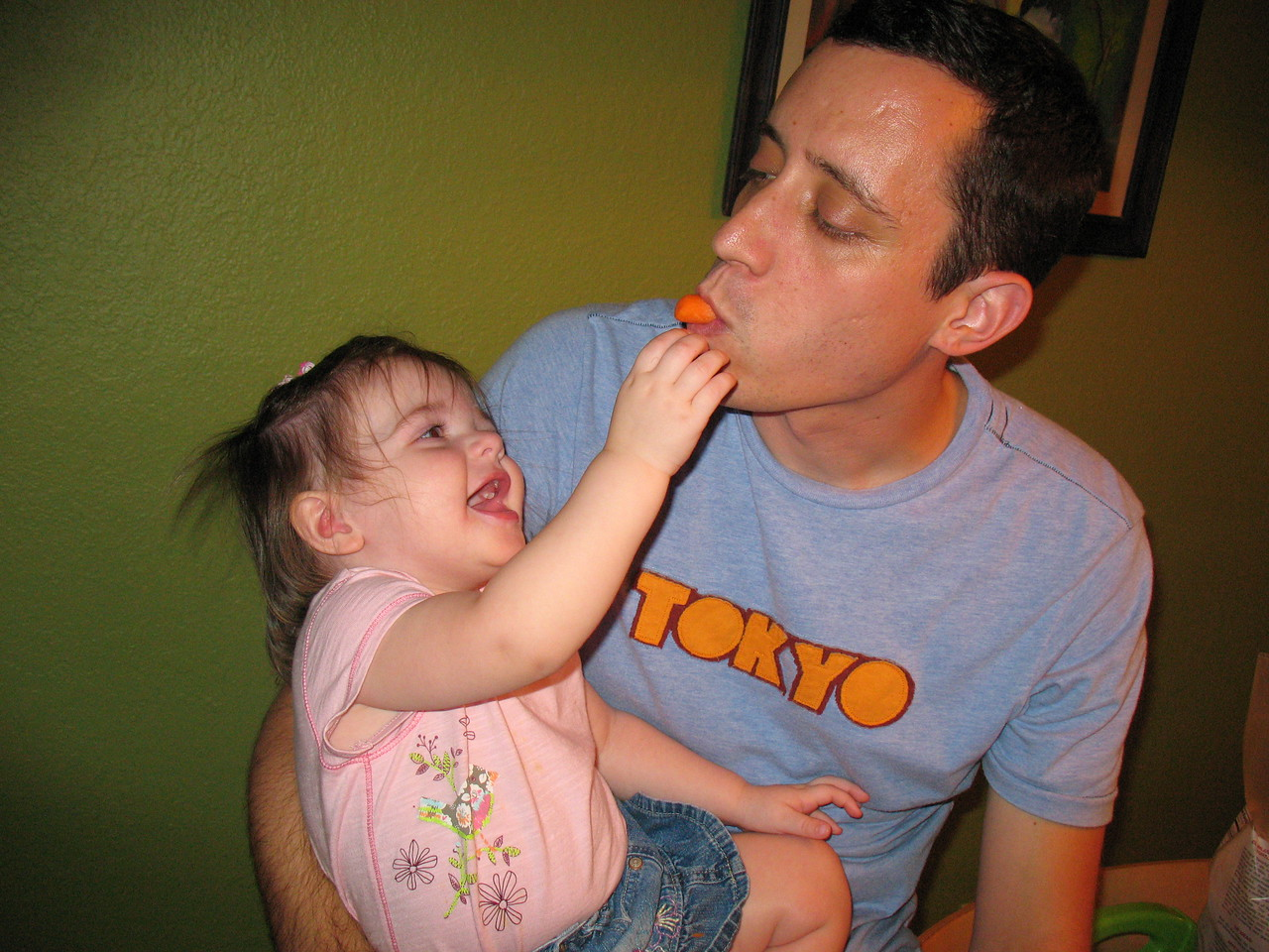 Stella feeds Daddy carrots, which is HI-larious!