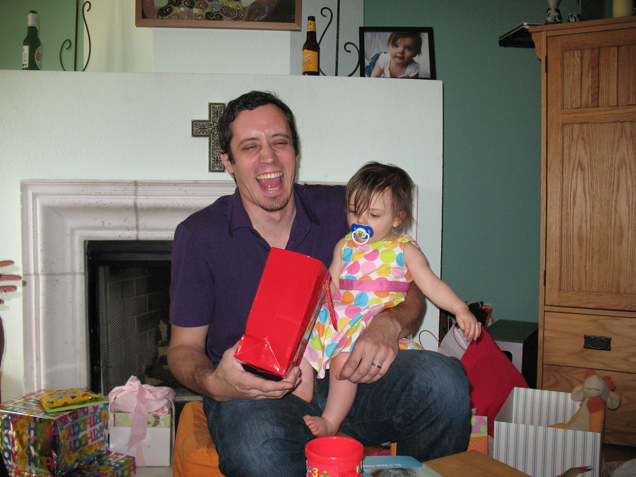 I think Tim is laughing at the Fat Monkey Erin got Stella, but he also could be having some sort of attack.