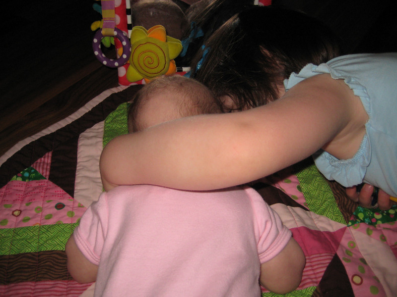 Coaching Etta on tummy time.  Check out that bald spot!