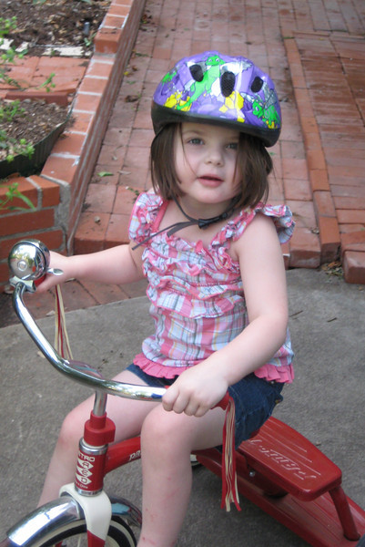 She's really got the hang of her tricycle now