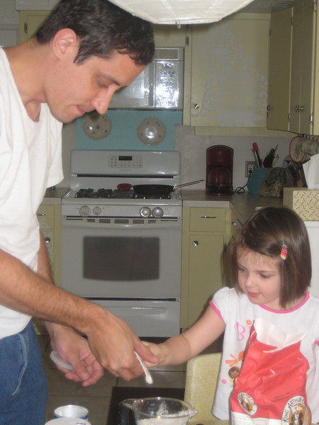 Daddy and Stella making cookies