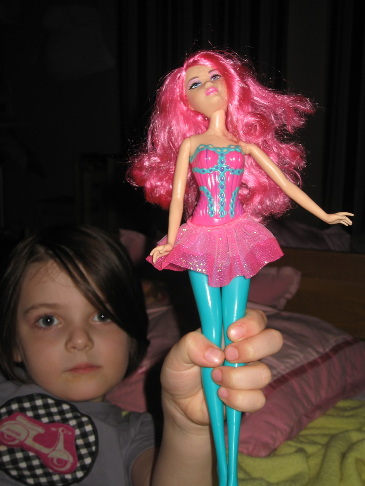 Stella and her new Barbie, bought to replace the one Etta ripped the arm off of.