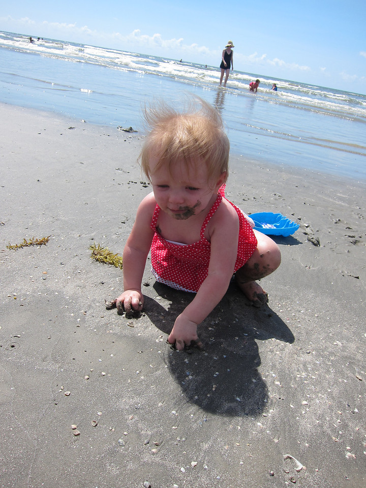 sand covered baby
