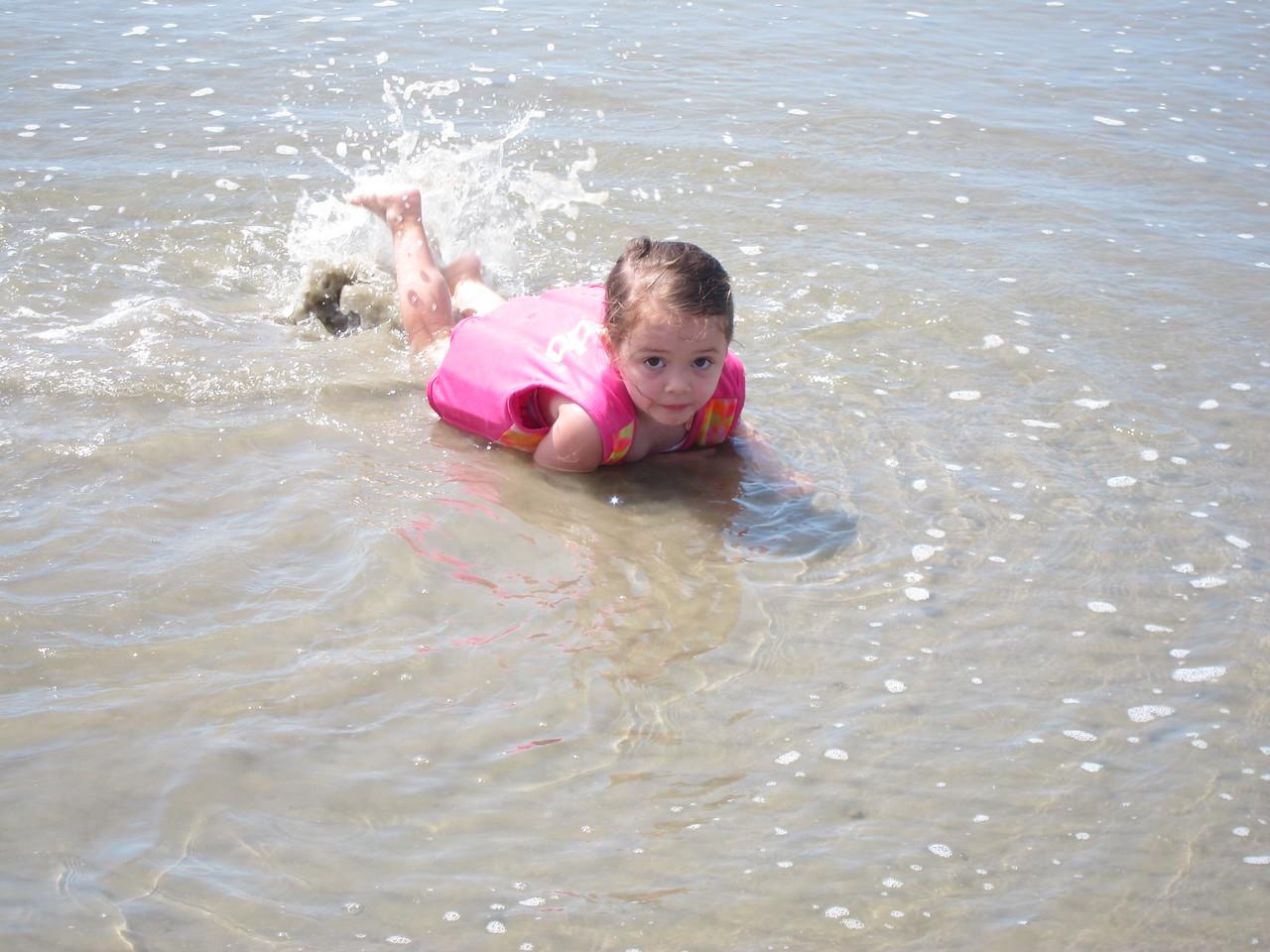 Georgia splashes in the surf
