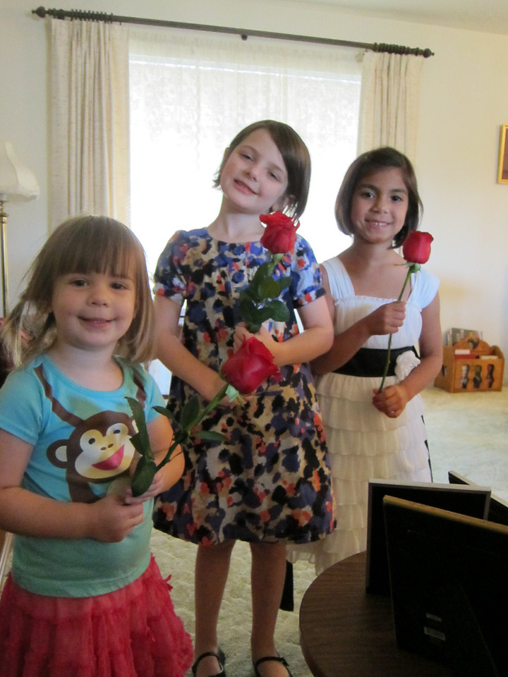 The great-grandaughters with their roses