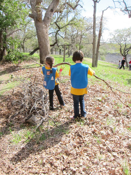 Eva and Stella carrying a giant branch
