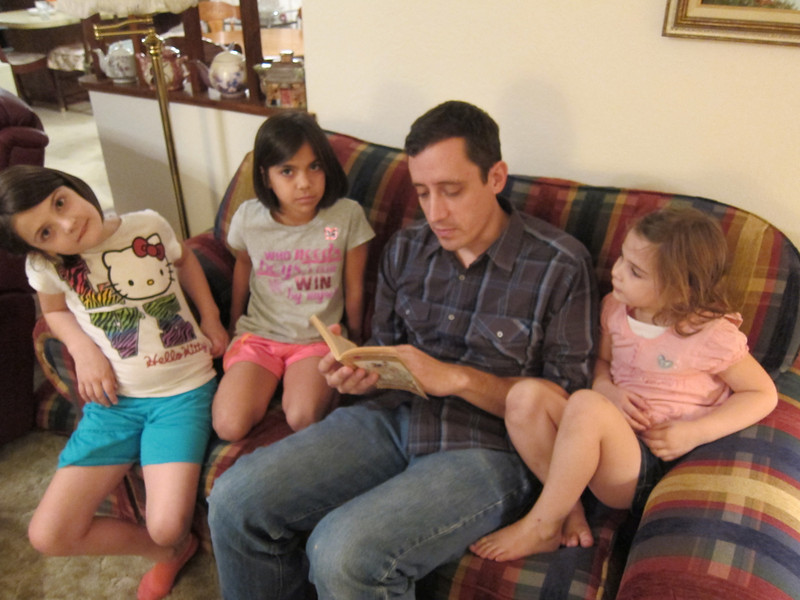 Tim reading to the girls