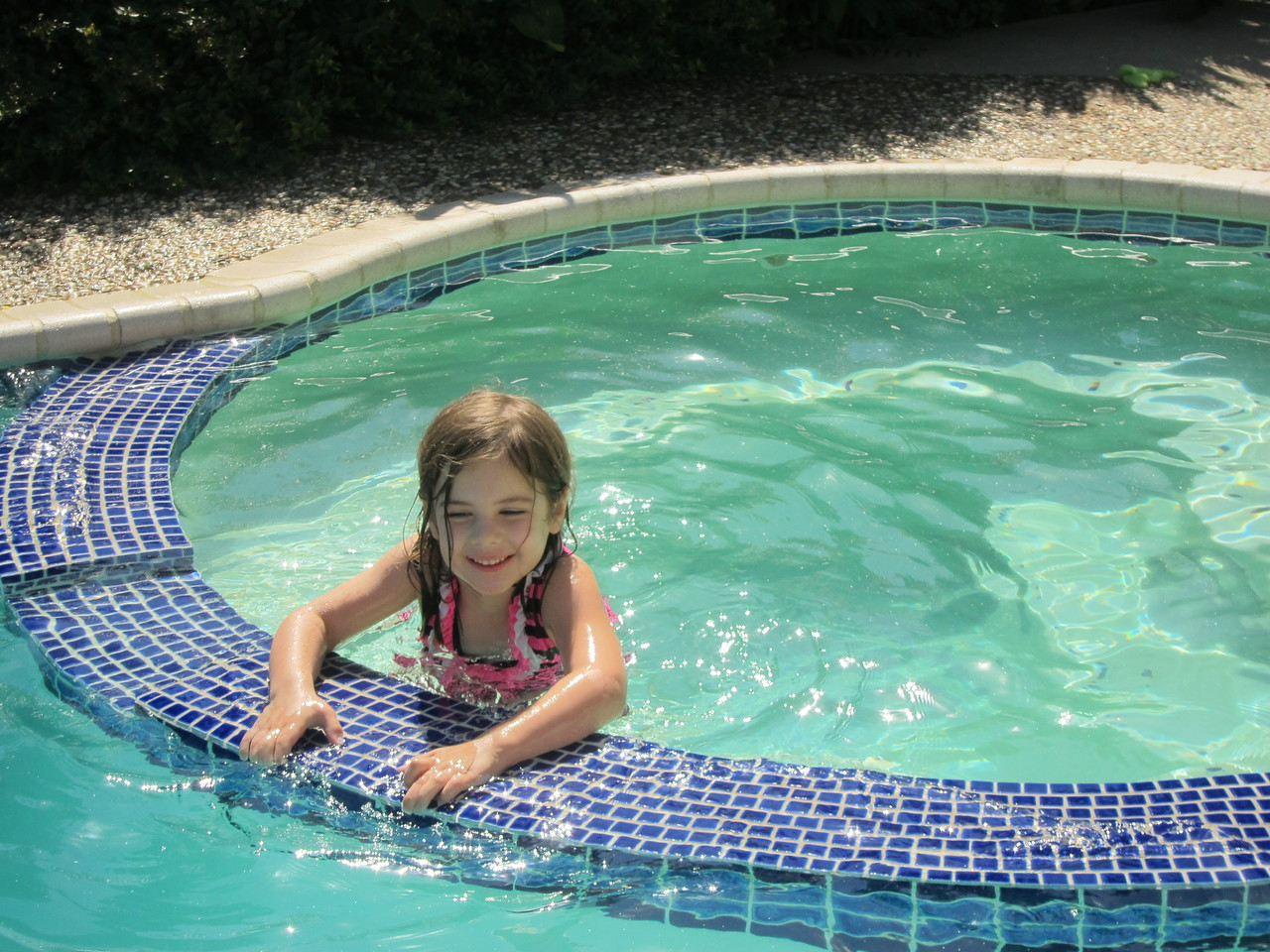 Etta enjoys the (cool) hot tub