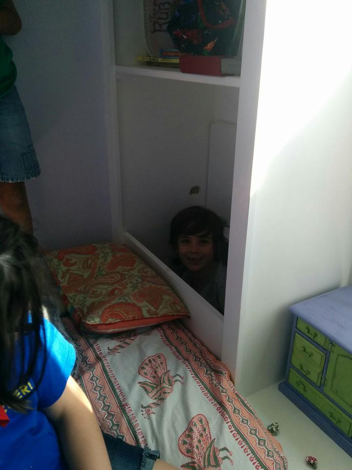 Etta hiding in the toy chest at Savannah's