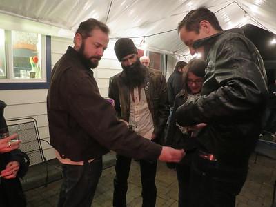 Sean examining Tim's belt.  Luckily everyone is secure in their manhood