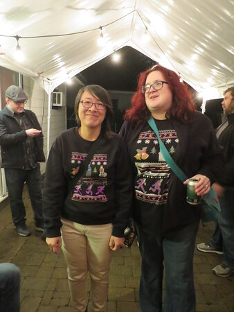 """Melinda and Theresa in their awesome matching """"Jingle Bells, Batman Smells"""" sweaters"""