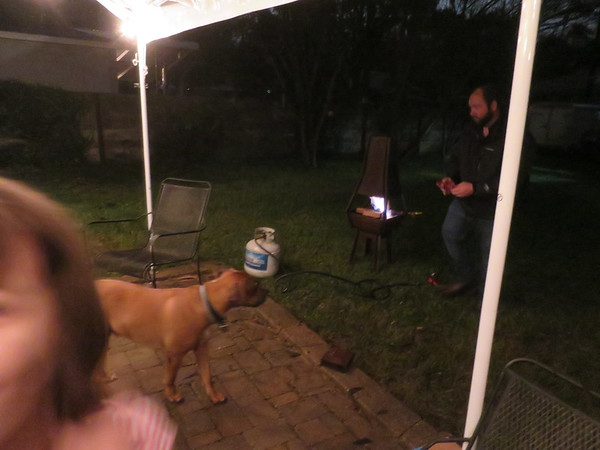 Eli gets a fire going with propane.