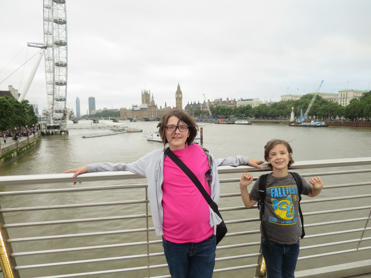 The girls on the Millenium Bridge with Parliament and the London Eye in the background