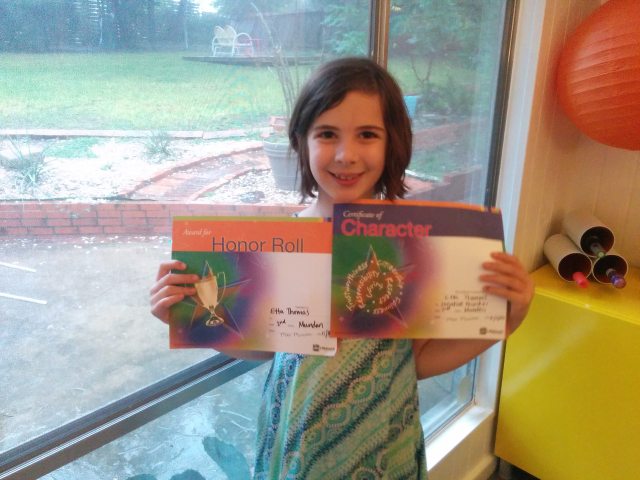 Etta got an Honor Roll and Creative Thinker Awards
