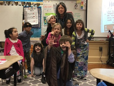 Etta and her class on the 100th day of school looking old.