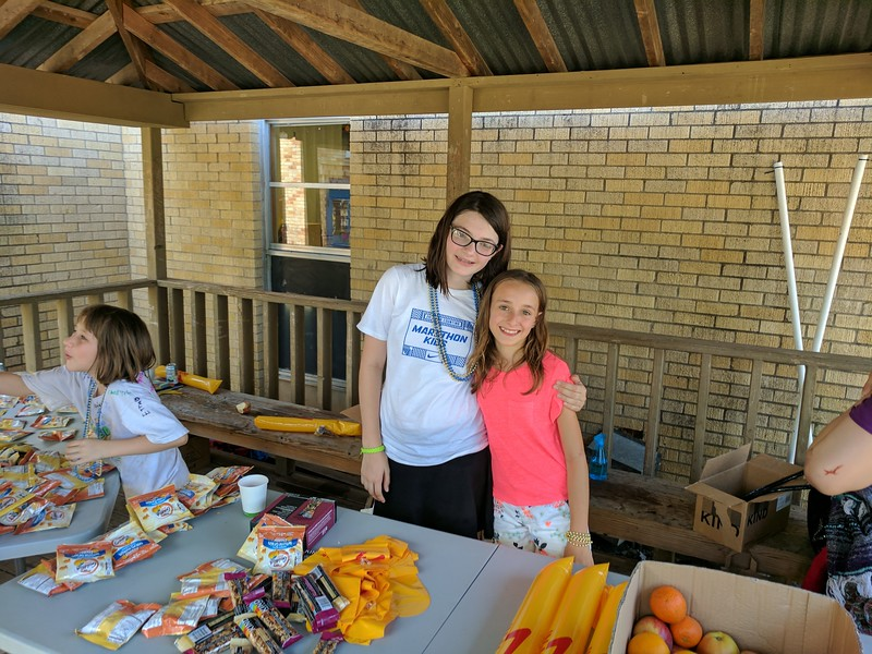 Stella and Adrienne volunteering at the snack tent.  Such sweet friends.