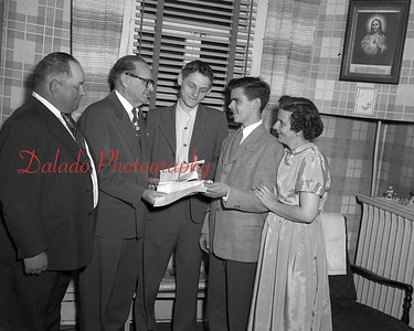 (04.26.1953) An Air Force certificate is being presented to Henry Baranoski, center, and John Zanders for 100 hours of service as air observers at the Shamokin tower on April 26, 1953. Major Paul Robinson, county chief, is shown presenting the award. Left is John A. Zanders Sr. and on the right is John Sanders.