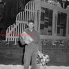 (May 1955) Unknown man next to the Sixth Ward Honor Roll.