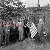 (05.15.52) Little Mahanoy Honor Roll- Presentation of a flag highlighted a ceremony recently by Woodman of the World Camp 29, Trevorton. The flag and a small pine tree were presented to the Lutheran and Reformed churches of Hunter Station. Henry Klugh, Harrisburg, national director of the Woodman of the World lodge, is shown making a formal presentation to Rev. Charles Snyder and Rev. Jacob Singer.