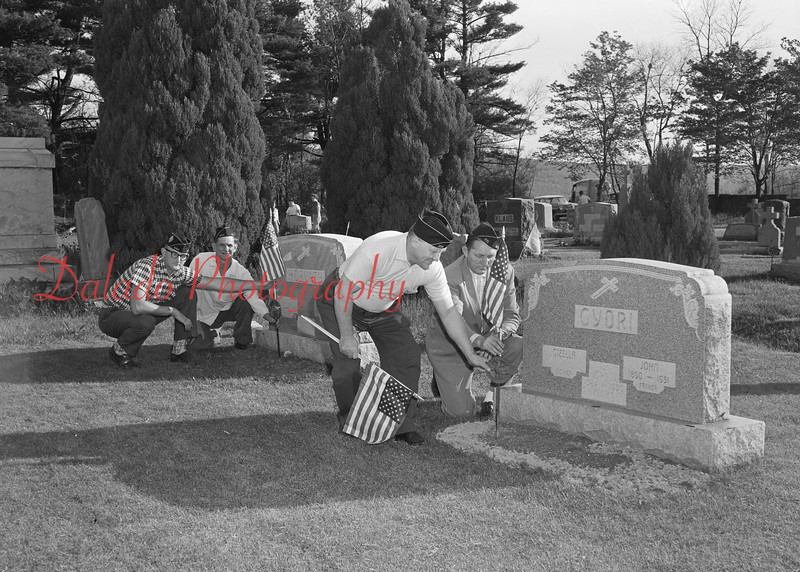 (May 1960) Members of the Kulpmont Veterans Organizations have started decorating graves in the community. Pictured, in front, are John Romanoski and Lop Horvath., and in the rear are Joseph Winhofer and Edwin Dobson.