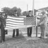 (Sept. 1962) The Trevorton American Legion Post presented a flag to Trevorton High School for the football stadium. Presenting the flag are Commander Theodore Worobel, left, John Donovan, Sgt. At Arms, and Edward Cox, senior vice commander, to William Lewis, supervising principal at school.