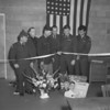 (02.23.56) Participating in a ribbon cutting ceremony, marking the opening of new headquarters along Route 122 near Weigh Scales, are members of the local Army Reserve Unit. Pictured are, Sgt. Marlin J. Ray, Capt. William Kemp, Major Lynn Cochran, and Sgt. Major E. Norman. Cutting the ribbon is Major Lester Derr and on the extreme right is Sgt. Ben Frank.