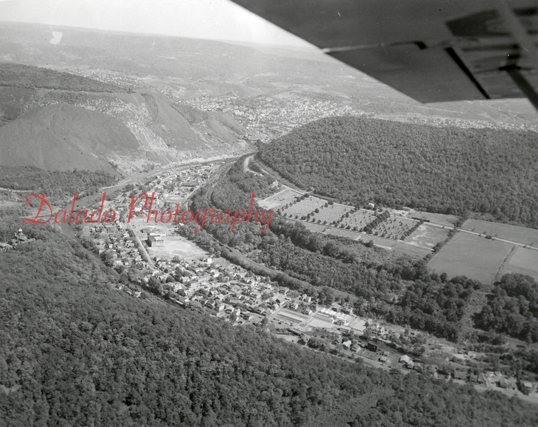 Another view, but this time higher and above Little Mountain, which divides Ralpho and Coal townships. Many things in this photo: Shamokin General Hospital at center-left, a natural land divide between two culm banks on the Glen Burn Bank, and two trains on separate lines just above the village.