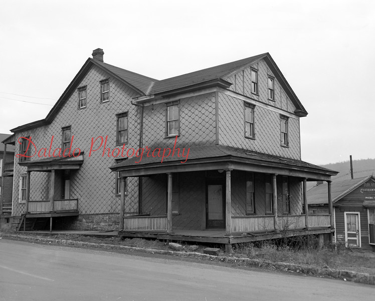 (11.19.53) Brady's first hotel, built in the late 1880s, continued as such for many years  and was a popular stopping place for farmers and travelers. For a number of years, however, the building has been occupied by several families. The building was discontinued as a hotel around 1942 and was eventually demolished.