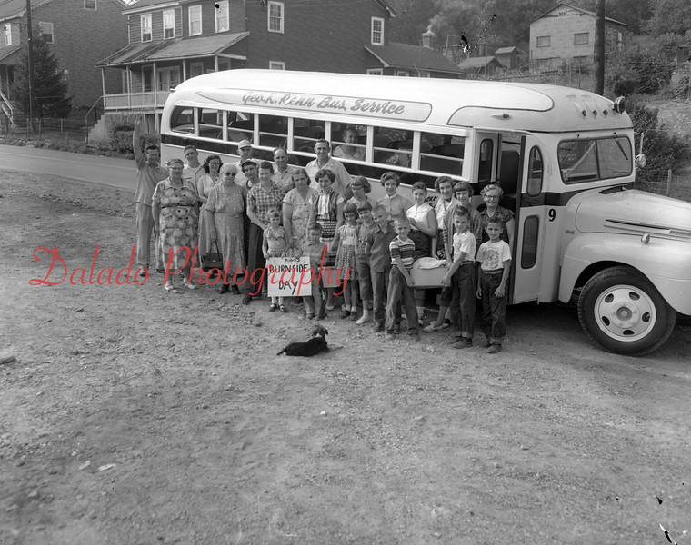 (08.04.1955) Burnside Day on Aug. 4, 1955. Holding the sign are Iris Fegley and John Chesney. Children are, front row, Linda Chesney, Annetta Price, James Zimmerman, Ralph Young, Henry Snyder and Kenneth Snyder; second, Joseph Long, Alphonee Zimmerman, Florence Zimmerman, Martha Zimmerman, Irene Fegley, Ruth Chesney, Dorothy Yeager, Judy Zimmerman, Jane Yeager, Sarag Price, Ruth Ann Chesney, Bonnie Chesney and Beatrice Zimmerman; thid, Jacob Zimmerman, Timothy Kerstetter, Alphonse Zimmerman, Ralph Long and Clarence Fegley. This is the annual picnic at Sunnybrooke Park