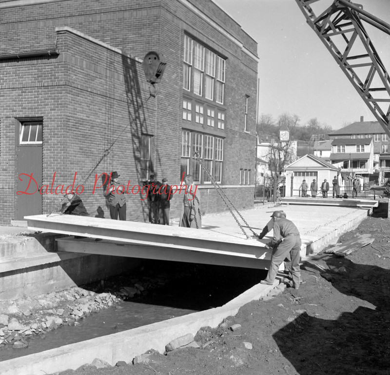 (1956, April through July) Capping Quaker Run next to the St. Anthony School in Ranshaw.