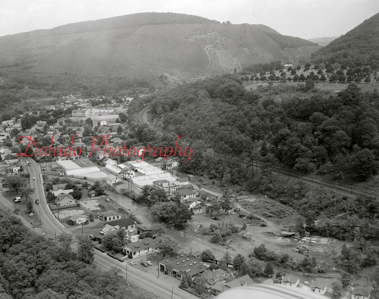 Uniontown as seen from above the Brewery Curve. If you notice, Route 61 travels through the village, and not along Goss Hill (right). A new bridge at the Brewery Curve and a four-lane highway from the Wayside Inn to the upper-end of Tharptown were opened in 1967. <br /> <br /> NOTE- The Uniontown Grade School is also seen in the upper-left portion of the photo. This is now the location of the playground.
