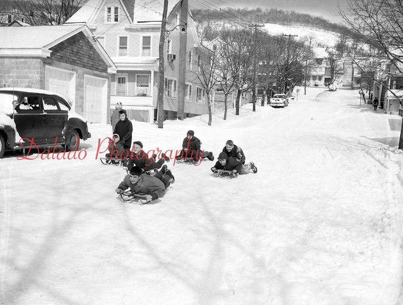 (Feb. 1955) Sledding down a street between Arch and Walnut.