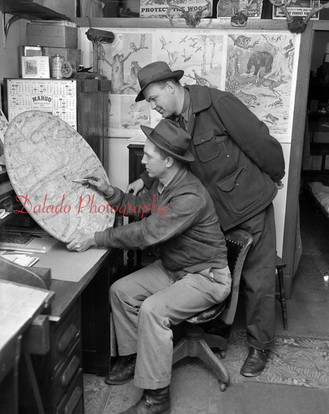 (March 1957) Boyers Knob in Coal Township. Foresters in March 1957 are Frank Graboski and Lamar Rohrer pinpointing where fire may develop.