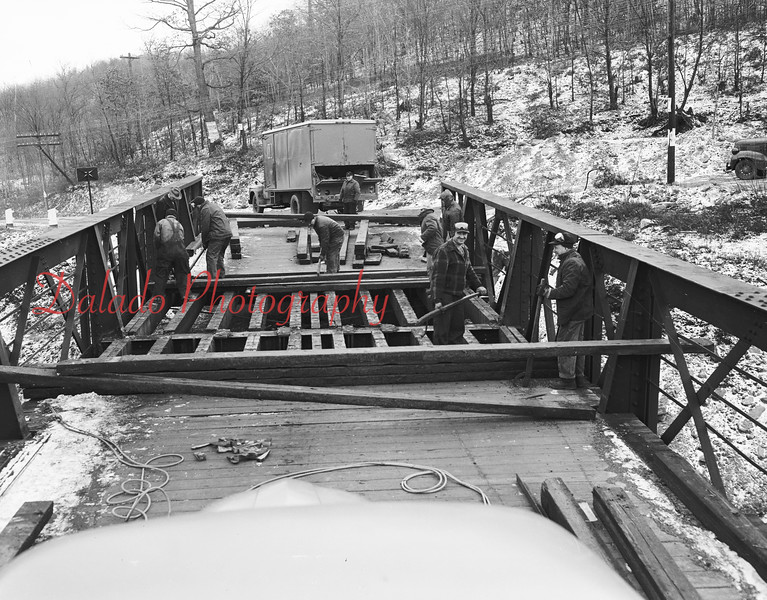 (01.19.56) Reading men fixing a bridge near Excelsior.