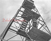 (05.08.1952) Perched on top of Boyer's Knob, 1700 feet above sea level, is a 50-foot steel tower that is home, four months out of the year, to John O'Leary, fire warden and protector of state forests in the Shamokin Area. O'Leary will record rainfall and wind data, and checks the moisture in the air by taking three pieces of wood, which have been placed 8-inches off the ground, weighing them and recorded the weight. On a clear day he can see for more than 15 miles in any loft.